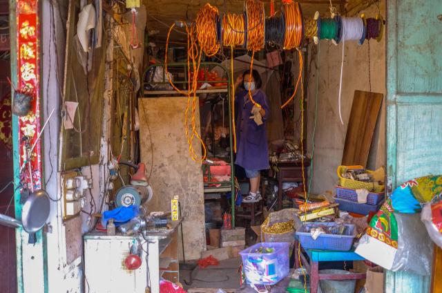 Electrical equipment shop in an urban village, Elosua Miguel